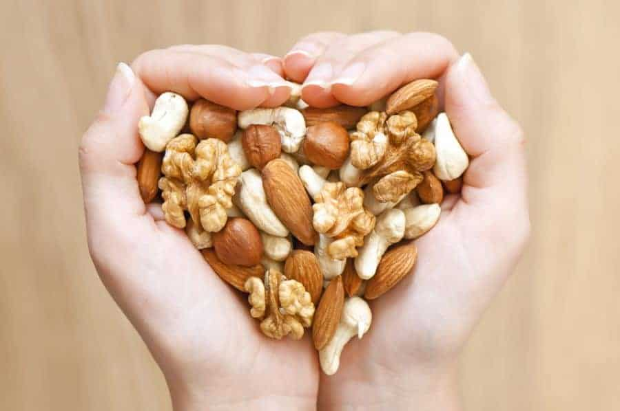 nuts and seeds in the palm of a hand