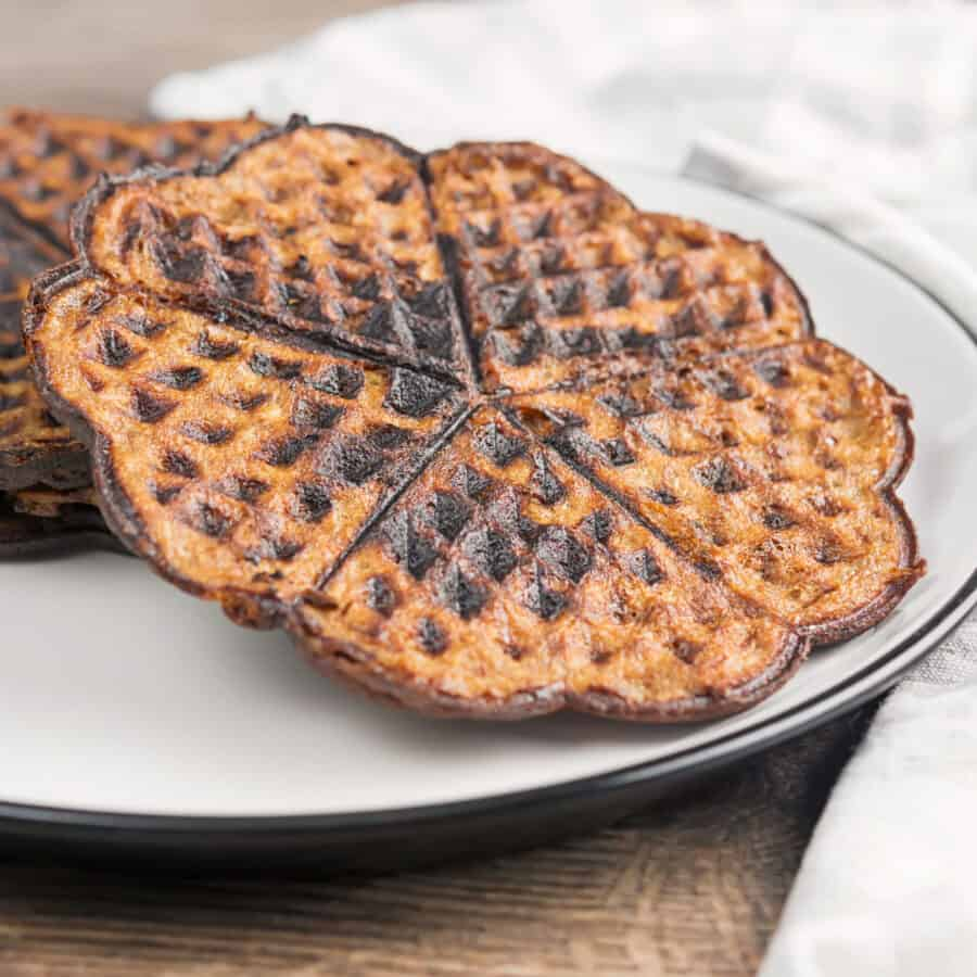 chocolate chaffles on a white plate sideways