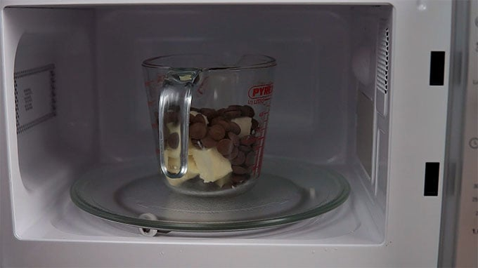 Side shot of chocolate chaffle ingredients in the microwave.