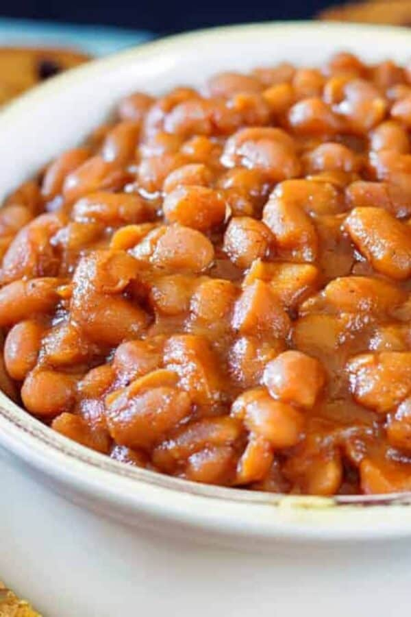 Close up image of Instant Pot baked beans served in a white bowl