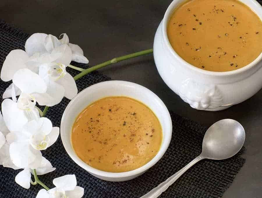 A bowl of Butternut Ginger Soup with a spoon.