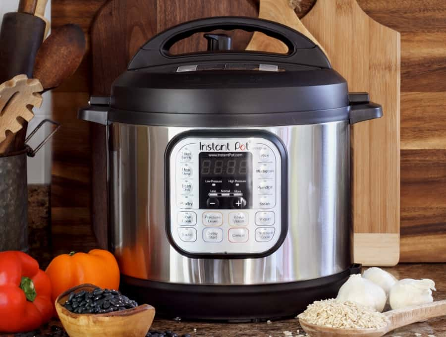 Instant Pot with vegetables surrounding it.