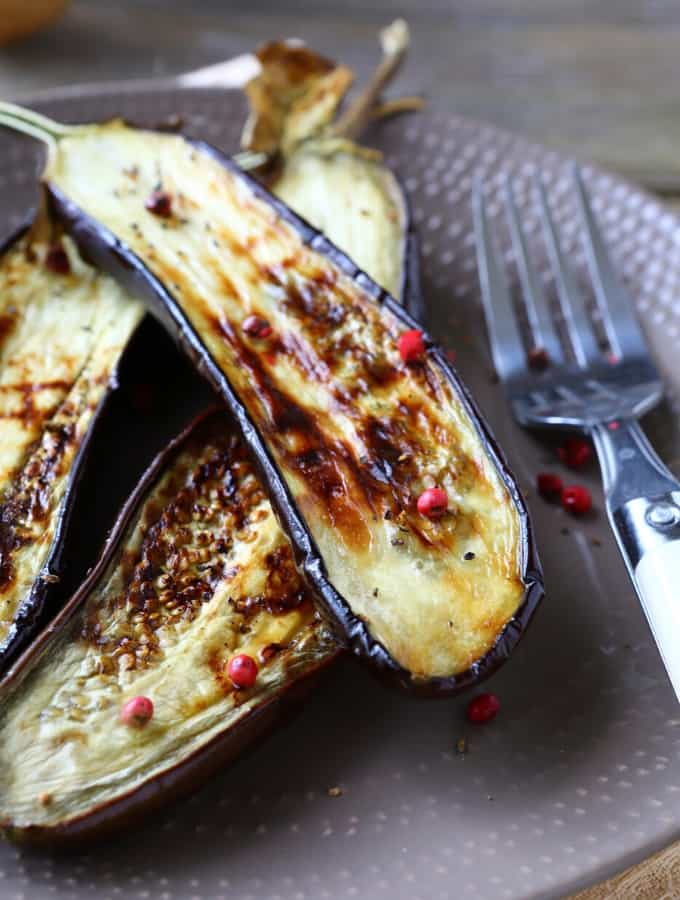 A plate of Roasted Eggplant with a fork.