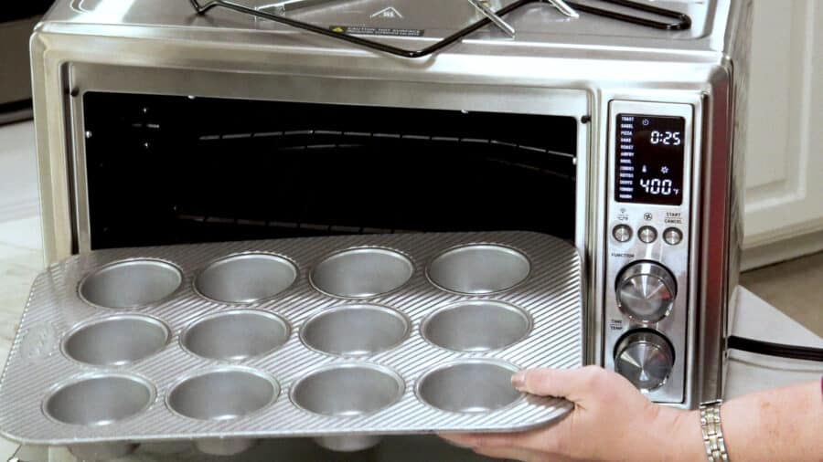 Side Shot Of My Usual Muffin Pan Being Placed In The Oven