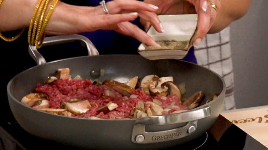 cook ground beef mushrooms onions and seasonings in a skillet