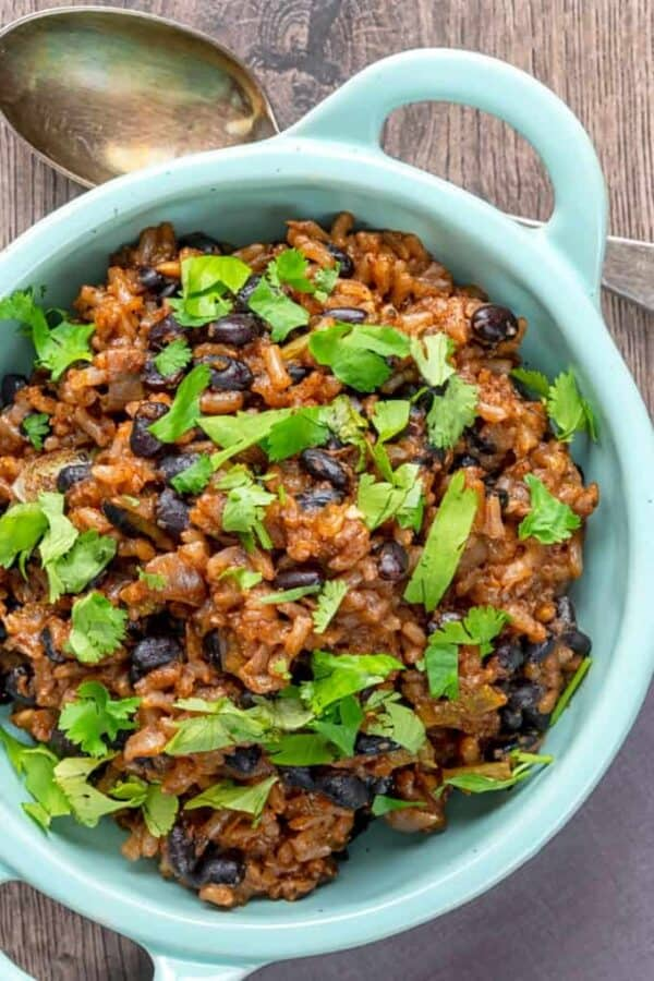 Overhead image of Instant Pot Black Beans and rice served in a light blue bowl