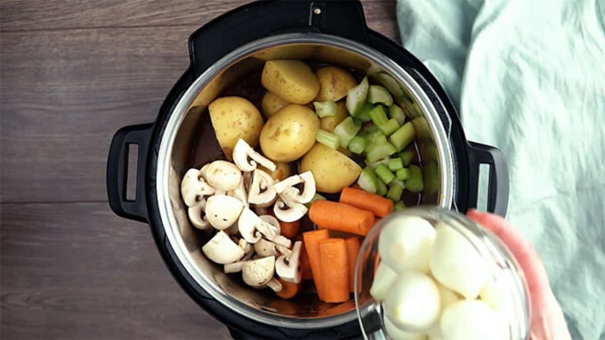 uncooked mushrooms, potatoes, carrots, and celery in the instant pot