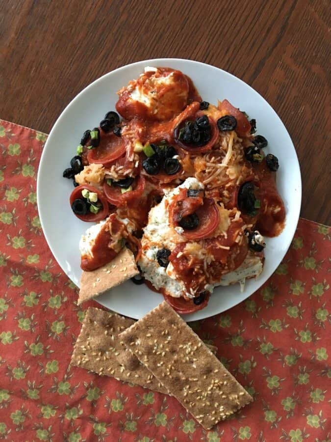 Keto pizza casserole on a plate served with crackers
