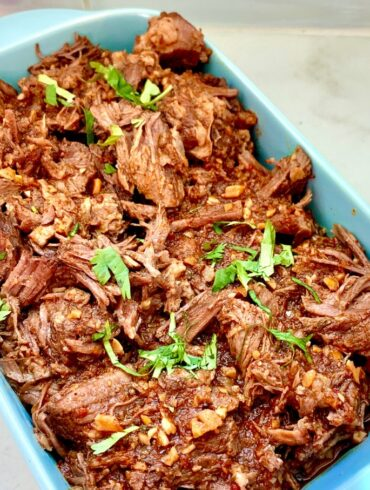 Beef Barbacoa served in a blue dish