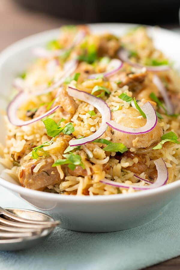 Instant Pot Chicken Biryani Served in a white dish