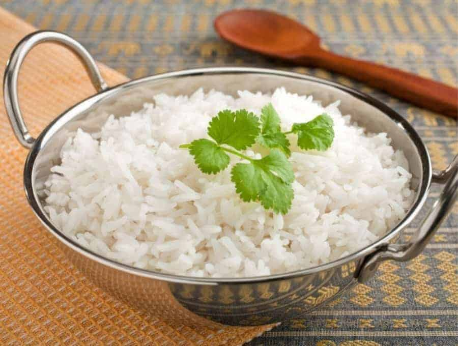Instant Pot Basmati Rice in a metal bowl with a parsley garnish.