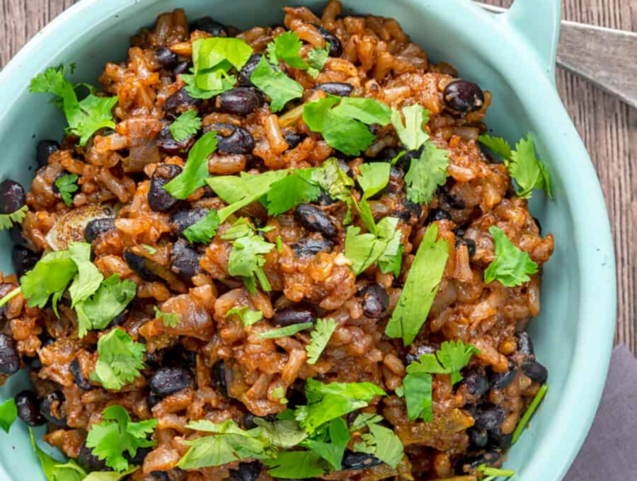 Overhead image of Instant Pot Black Beans and Rice served in a light blue bowl.