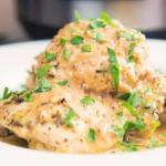French garlic chicken being served in a white bowl