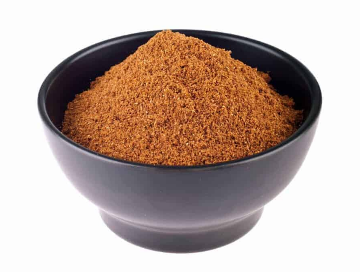 Lebanese 7 Spice Mix in a black bowl with a white background.