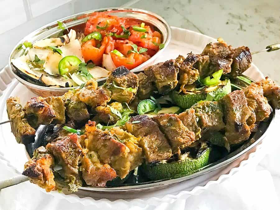 Grilled beef kebabs on two skewers