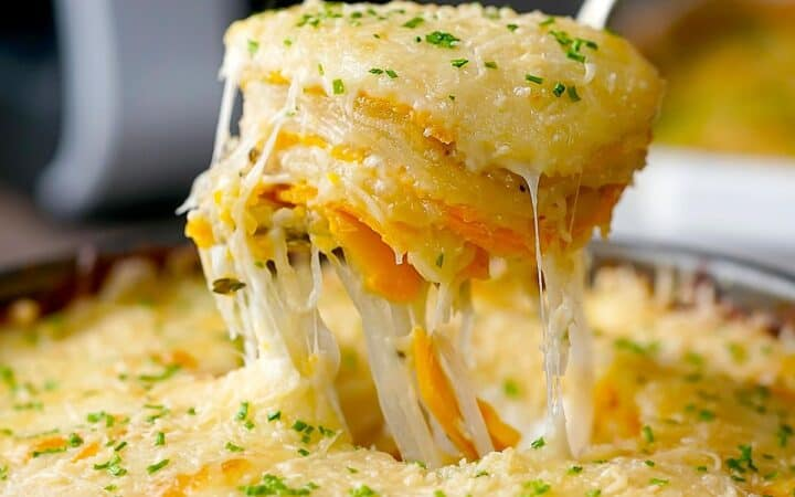 The cheesy potatoes being served on a spoon
