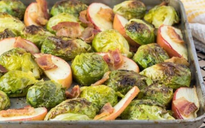 Overhead image of brussel sprouts with bacon on a cooling rack.