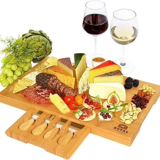 charcuterie board with serving utencils