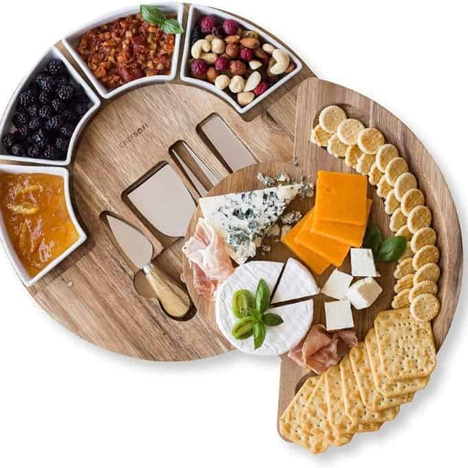 circular charcuterie tray with serving utencils