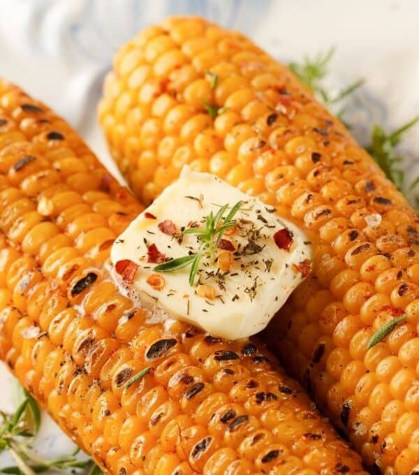 Seasoned Air Fryer Corn On The Cob WIth a Big Slab Of Butter