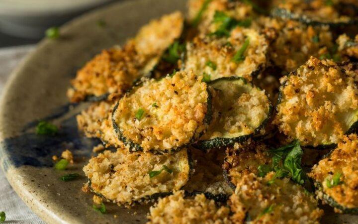 AIr Fryer Zucchini on an earth tone plate