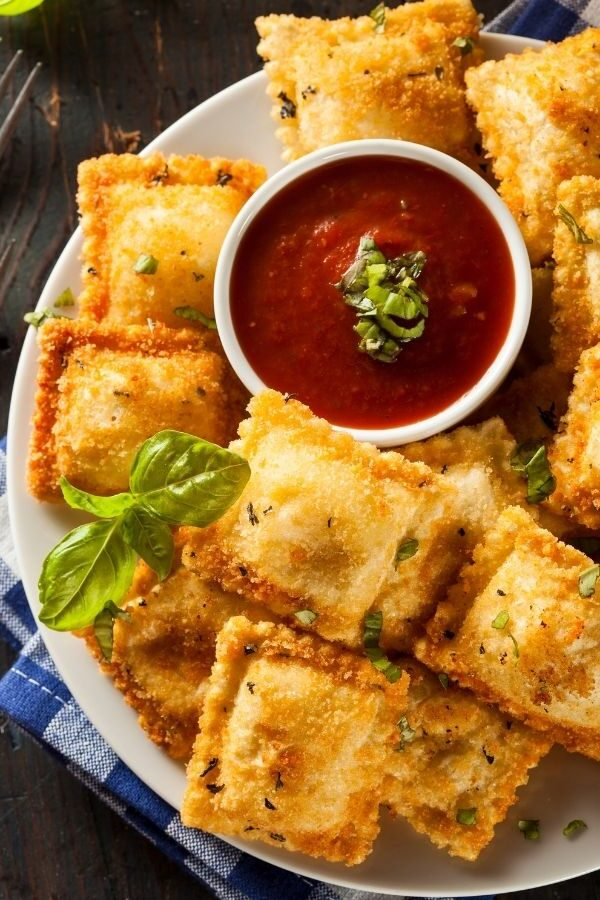 Air Fryer Ravioli on a plate with marinara dipping sauce